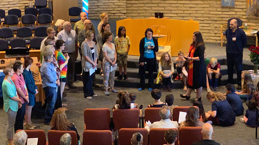 Rev Christine Dance in sanctuary with new members during new member service