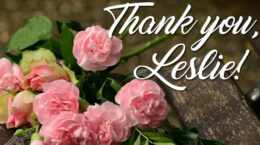 """""""Thank you, Leslie"""" white text over pink roses"""